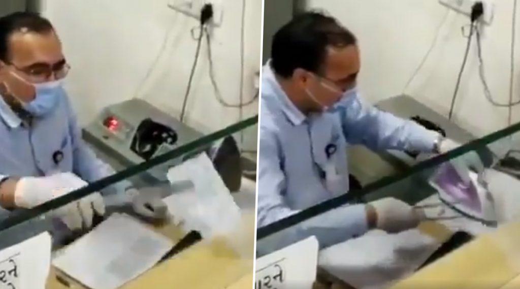 Viral Video: ইস্ত্রিতে সেঁকে চেক জীবাণুমুক্ত করছেন ব্যাঙ্ককর্মী! ভাইরাল ভিডিয়ো