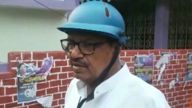 West Bengal Assembly Elections 2021: হেলমেট পরে বুথে বুথে ঘুরছেন নাটাবাড়ির তৃণমূল প্রার্থী রবীন্দ্রনাথ ঘোষ