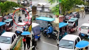 Assam: ছাতা ধরে বাইক আরোহীর পিছনে ছুটছে পুলিশ, ভাইরাল ভিডিয়ো